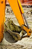 Yellow backhoe claw bucket Royalty Free Stock Images