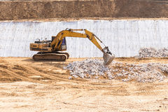 yellow backhoe work in the dam Stock Photo