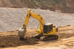yellow backhoe work in the dam Royalty Free Stock Photo