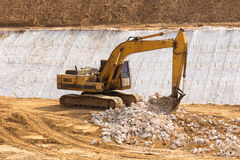 yellow backhoe work in the dam Stock Photography