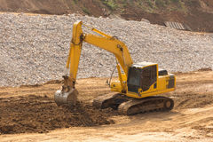 yellow backhoe work in the dam Royalty Free Stock Photos
