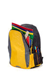 Yellow backpack with school supplies stock image