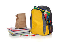 Yellow backpack with school supplies Royalty Free Stock Photography