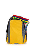 Yellow backpack with school supplies Stock Photos