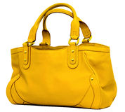 Yellow Bag. Modern yellow leather women's handbagbag on the white background royalty free stock image