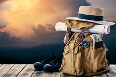 Yellow bag for backpack and nature background. Concept travel around the world stock photo