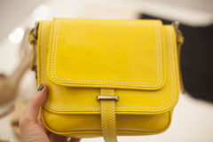 Yellow bag in a hand Royalty Free Stock Images
