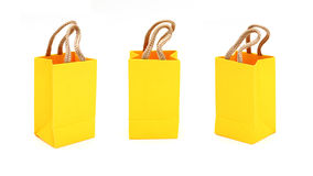 Yellow bag with purchases on the white Stock Photo