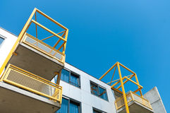 Yellow balconies Stock Images