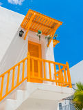 Yellow balcony and door and white wall Stock Images