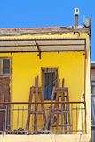 Yellow balcony with easels Stock Photo
