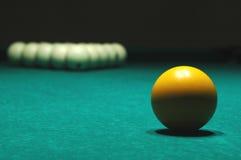 Yellow ball on billiard table Royalty Free Stock Photo