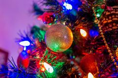 The yellow ball garland. On the Christmas tree Stock Images