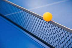 Yellow ball hits the net Royalty Free Stock Image