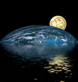 Yellow ball over water. Two large planets reflecting over smooth waves on water Royalty Free Stock Image