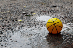 Yellow ball in wet field Royalty Free Stock Images