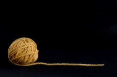 Yellow ball with yarn Stock Images
