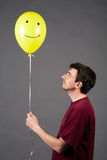 Yellow Balloon. The man with the yellow balloon Royalty Free Stock Images