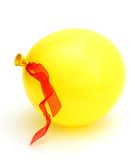 A yellow balloon. With ribbon alone Royalty Free Stock Photos