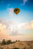 Yellow balloon above the earth Royalty Free Stock Images