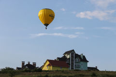 Yellow balloon in blue sky in Schodnica, Ukraine stock image