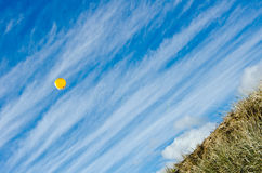 Yellow balloon in the Blue sky Stock Photo