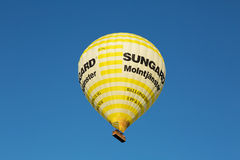 Yellow balloon flying over Stockholm city. Stock Photo