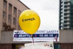Yellow Balloon at Political Rally - Enough. Yellow balloon at a political rally, reflecting the frustration in the political process - Enough royalty free stock photos