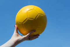 Yellow balloon in the sky. A yellow ball for the world championship in Brazil Stock Photos