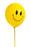 Yellow balloon with smile Royalty Free Stock Photography
