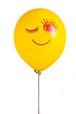 Yellow balloon with smile Stock Image