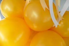 Yellow balloon and yellow and white ribbon Royalty Free Stock Photos