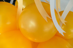 Yellow balloon and yellow and white ribbon Royalty Free Stock Image