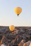 Yellow balloons flying in sky, sunrise time Royalty Free Stock Images