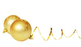 Yellow balls and golden ribbon. Isolated on white Stock Photography