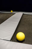 Yellow balls left on black trampolines Royalty Free Stock Images