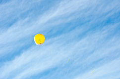Yellow Baloon. In the  blue sky, New Zealand Stock Photos