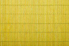 Yellow bamboo mat Stock Images