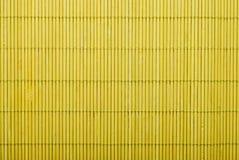 Yellow bamboo mat stock images