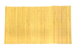Yellow bamboo mat on white Royalty Free Stock Photography