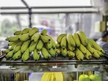 Yellow banana on the back of clear glass cabinet. On blurred Background appetizing banaanas bananas bananasfruit bannannas basket bright bunch buy clipping royalty free stock photos