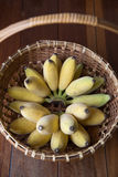 Yellow banana in basket with wood background and natural lighting Royalty Free Stock Photo