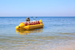 Yellow banana boat in a blue sea Royalty Free Stock Photography