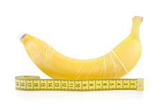 Yellow Banana with Condom and Measuring Tape Royalty Free Stock Photos