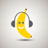 Yellow banana emoji listening to music with headset. Emoticon fo Royalty Free Stock Images