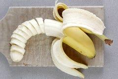 Yellow banana group. Monkey three peeled Stock Photo