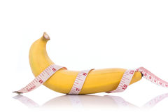 Yellow banana with measurement tape. Men penis size concept.Stu Royalty Free Stock Photography