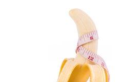 Yellow banana with measurement tape. Men penis size concept.Stu Stock Photos