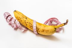 Yellow banana with measuring tape - diet concept Royalty Free Stock Photos