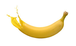 Yellow banana with paint splash Royalty Free Stock Photos